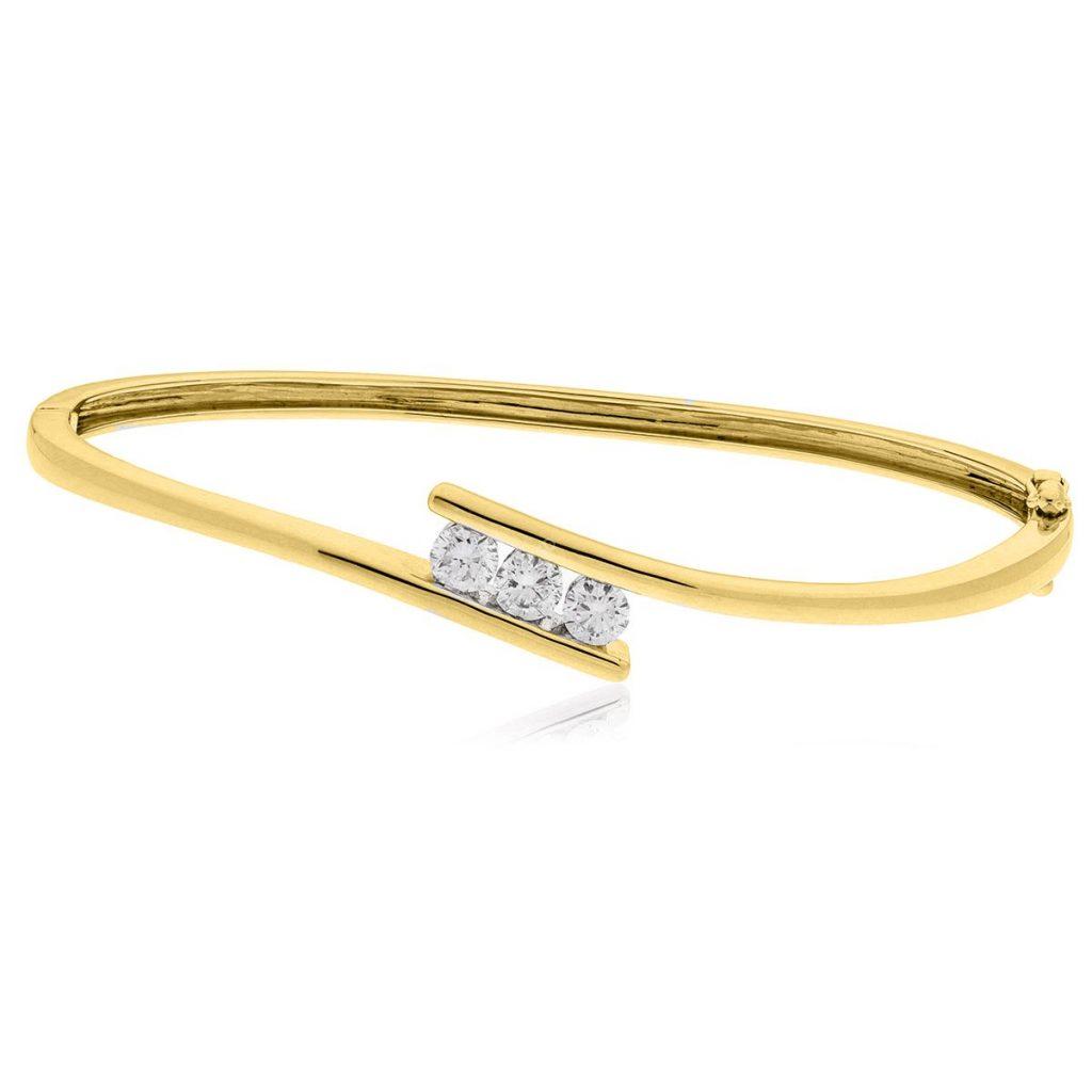 Channel Set Diamond Bangle in 18K yellow gold